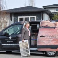 Floor Coverings International Franchise Owner in front of van